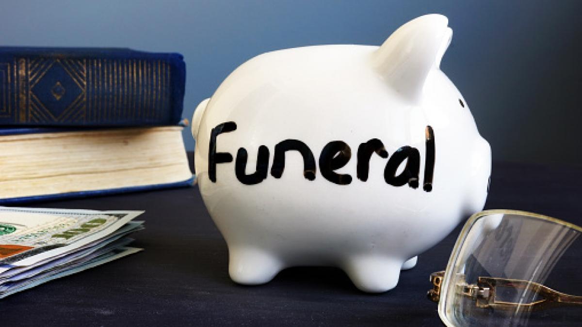 Funeral plan written on a side of piggy bank.