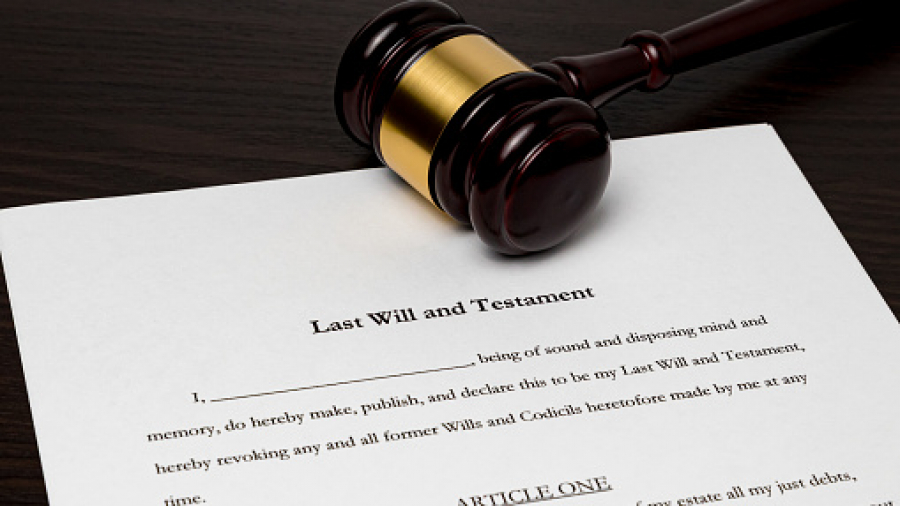 Last will and testament with gavel. Concept of planning for death, final wishes, probate court system, guardianship, inheritance tax and terminal illness.